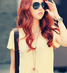 Girl with red hair and dark glasses